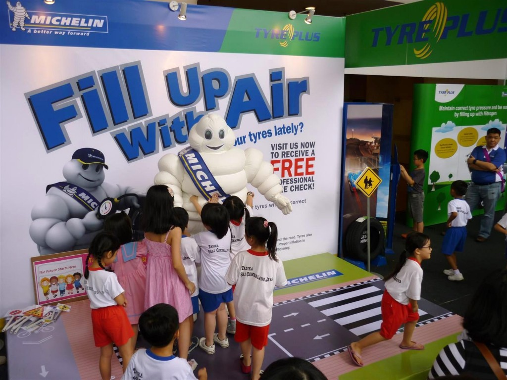 Children greeting the Michelin Man @ FUWA