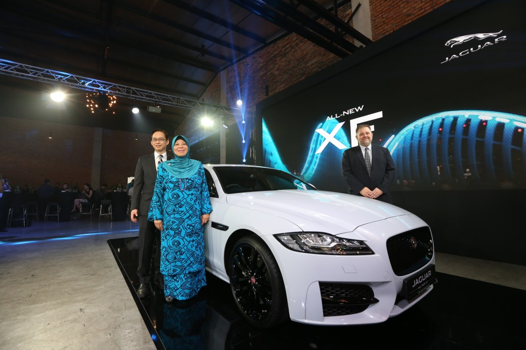 (L-R) JLRM Operations Director Steven Teo, MD Datuk Aishah Ahmad and Head of Aftersales Nicholas Fitt with the All-new Jaguar XF