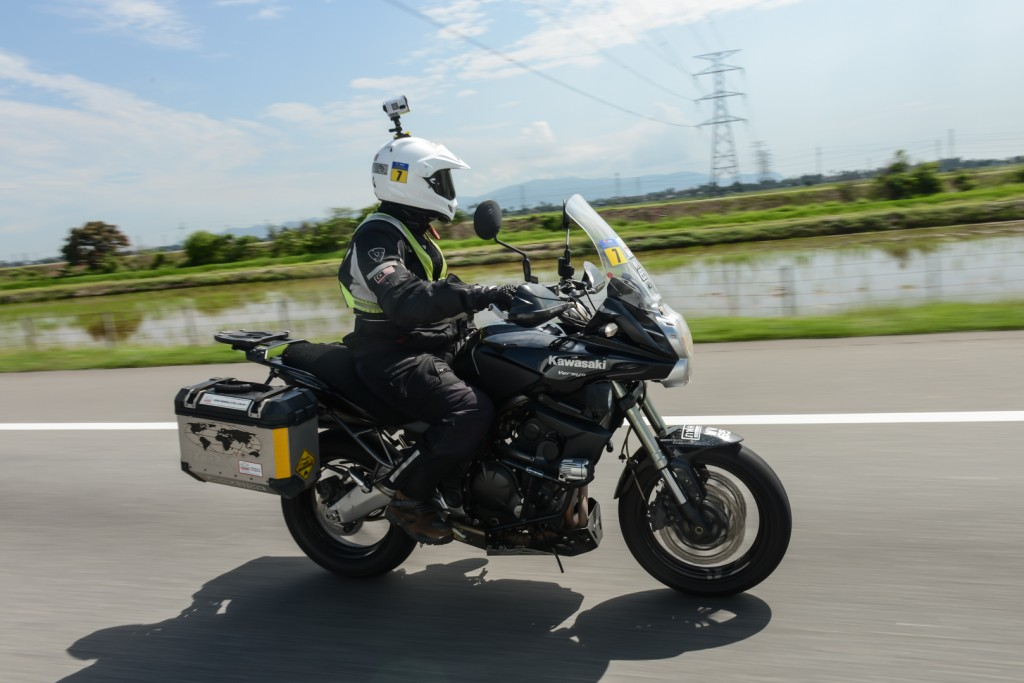 #Advance2Langkawi winner Zahed Abd Rahman riding past padi fields on his Kawasaki Versys 650