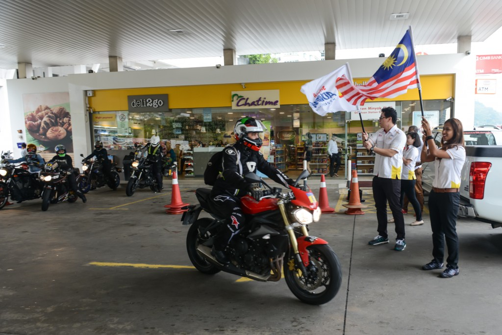 Shell Advance Brand Manager Desiree Cheng (R) and Digital Marketing Manager Ian Chook flagging off the #Advance2Langkawi riders