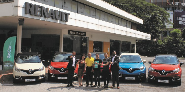 At the handover ceremony of Renault Captur to GoCar